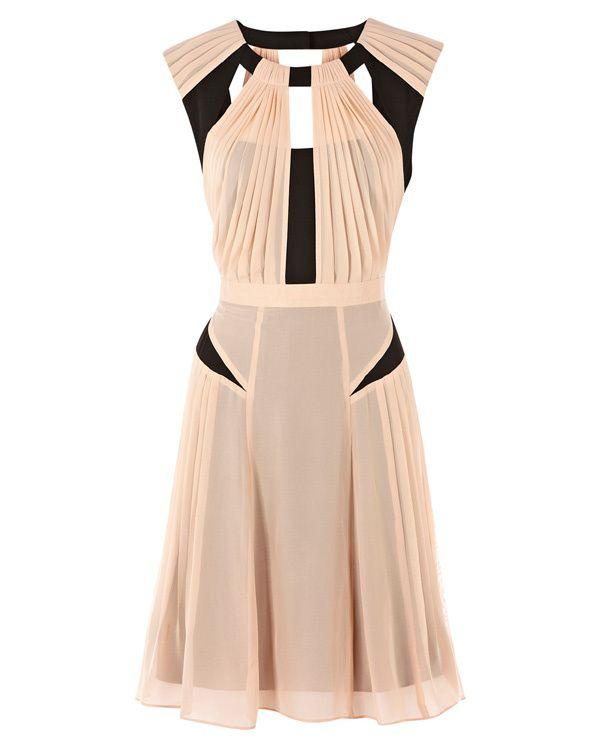Une robe graphique, drapée à découpes  Warehouse