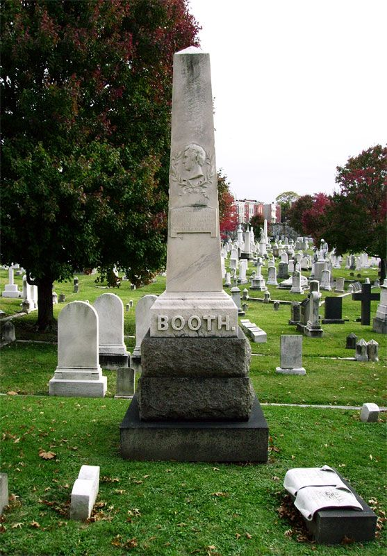Grave Marker- John Wilkes Booth, assassin, is shot dead near Bowling Green VA The body was buried in a storage room at the Old Penitentiary, later moved to a warehouse at the Washington Arsenal on Oct. 1, 1867. In 1869, the remains were again identified before being released to the Booth family, where they were buried in the family plot at Green Mount Cemetery in Baltimore, after a burial ceremony.