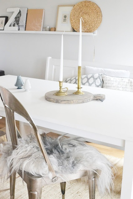 Love the contrast between the lamb skin and industrial chair in this soft feminine space