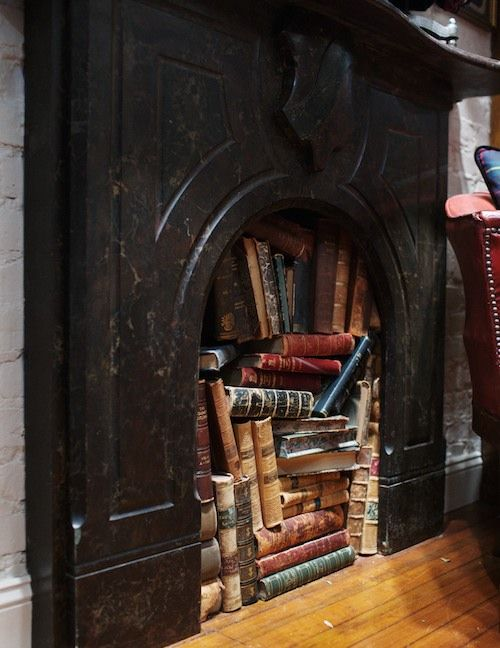 Books in a fireplace...cute idea if you live in the south and don't really need the fireplace too much!