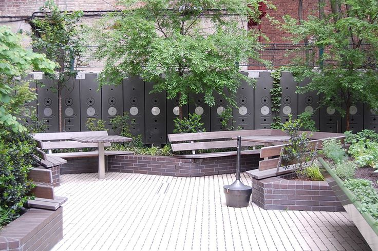LEED PLATINUM Rainwater HOGs installed by http://www.permascapedesigns.com  look fantastic!  A great example of BUG design: Beautiful/Useful/Green Examples of best practice rainwater collection systems using 50-gallon rectangular food-grade plastic HOG tanks vertically and horizontally, in schools, homes and businesses