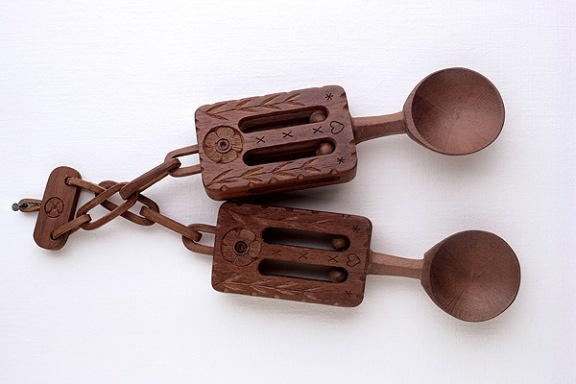 """Welsh love spoons...  men would carve a spoon for their beloved and """"decorate the whittled wood with different symbols: Keys would signify a man's heart, wheels his hard work and beads, his preferred number of offspring..."""""""