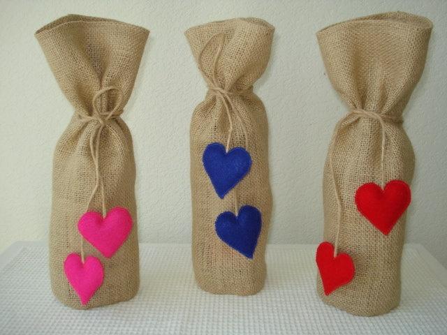 Wine Gift Bags with Ties Handmade Burlap Wine Bags Heart Ties Pink Red Blue. $9.00, via Etsy.