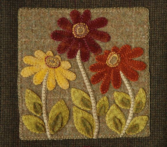 Prairie Wildflower - Wool Appliqued Wall Hanging PATTERN. Not including the hanging tabs, this piece finishes out to about 14 1/2 tall x 8 wide. Designed by Horse and Buggy Country. Pattern includes: a cover page with a color photograph, detailed instructions, a page of pattern elements printed on 110 lb cardstock paper. New Unused Copy from our Shop. Patterns Are Not Returnable. For more magazines, books and patterns in my shop click this link: https://www.etsy.com/...