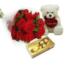 Bouquet di rose rosse con peluche e cioccolatini