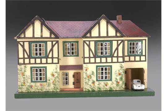 A Tri-ang dolls' house DH/77 1939, painted cream with wood timbering, metal windows, red tiled ro