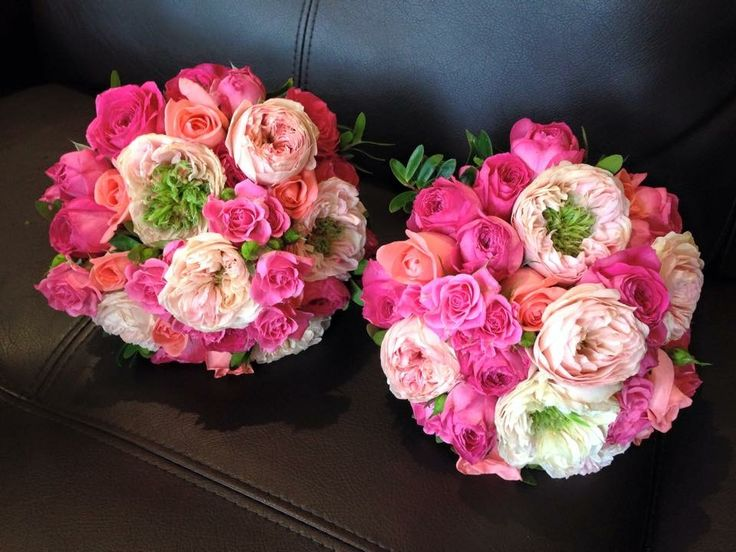 Hot pink cluster roses teamed with soft pink @weddingflowersetc