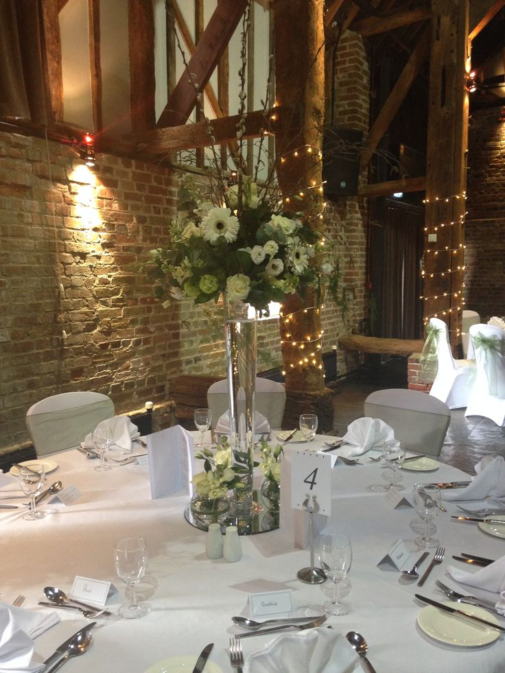 Tall wedding centrepiece, woodland/barn, greens and creams