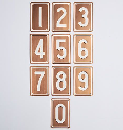 Copper House Numbers: Dial your curb appeal up a notch with our Copper House Numbers. Designed from copper plate with a contrasting white numeral design, they're uniquely made in Portland, Oregon by a 114-year-old company – the last remaining private license-plate manufacturer in the U.S., supplying Oregon, Washington, California, and Hawaii.