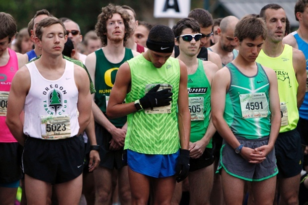 Runners observe a moment of silence for those killed and injured during the Boston Marathon bombing before the Eugene Marathon in Eugene, Oregon, United States. Photograph: Kevin Clark/AP