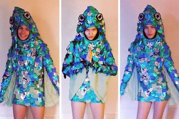 """Girl as René Magritte's painting 'Collective Invention,' - reverse mermaid  """"I went as the subject of René Magritte's painting 'Collective Invention,' better known by Google as the 'reverse mermaid.' It's the woman with the head of a fish. I made the costume myself  — with a concealed harness made of leftover curtain tape, a couple of bent wire hangers that formed a frame to support the fish head, and a lot of stretch lamé."""""""