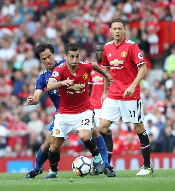 Henrikh Mkhitaryan of Manchester United in action with Shinji Okazaki of Leicester City during the Premier League match between Manchester United and...