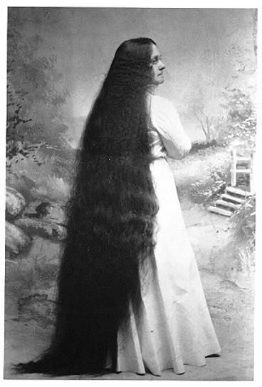 "Dora Sutherland. c. 1900: The Seven Sutherland sisters were a group of singing women from Niagara, New York, famous for their very long hair. The sisters spent much of their time traveling from city to city in side-shows from about 1882 until about 1907, and also posing in drug store windows or hotels lobbies. They went on to make millions of dollars with sales of hair tonic""  - The Rapunzel Long Hair Archive  Pictures from Niagara County Historical Society"