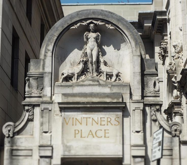 Sculptural detail on the side of Vintners' Hall, Upper Thames Street. It was first built in 1446 but destroyed in the Great Fire, today it's decorated with a young Bacchante figure feeding grapes to goats. Can you spot the swans either side of the arch too?