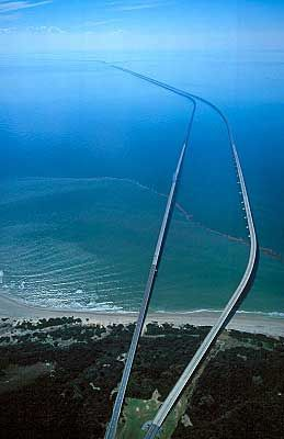 Virginia - Chesapeake Bay Bridge and tunnel is 17.6 miles long including two tunnels that are 1 mile each. It extends out into the bay and Atlantic Ocean connecting the mainland to the eastern coast. It is amazing. www.facebook.com/loveswish