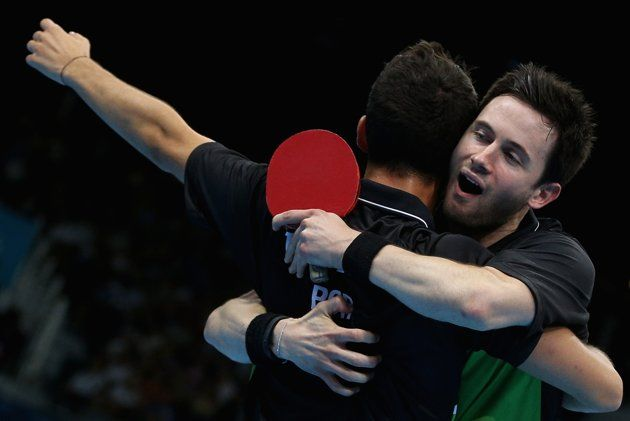 Joao Monteiro and Tiago Apolonia of Portugal celebrate during Men's Team Table Tennis first round match against team of Great Britain on Day 7 of the London 2012 Olympic Games at ExCeL on August 3, 2012 in London, England.