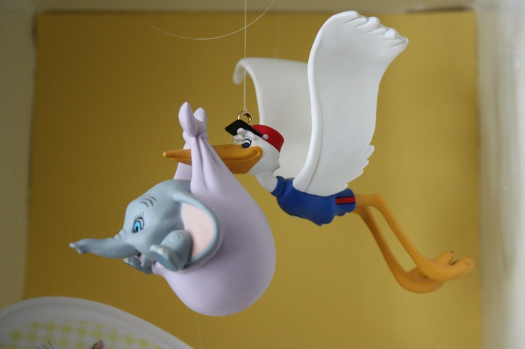 Using Hallmark Disney Christmas ornaments for baby shower displays.