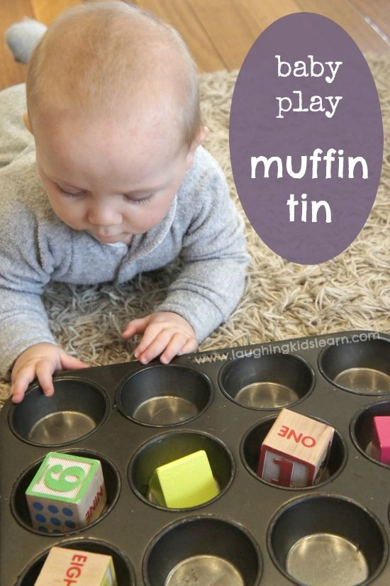 Sensory baby play activity using a muffin tin. Great for increasing tummy time and developing body awareness - Laughing Kids Learn