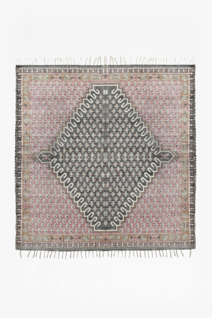 <ul> <li> Screen-printed durrie rug</li> <li> Block floral design</li> <li> Tassels on two sides with looped edges on remaining sides</li> <li> Available to purchase in medium size </li> <li> <strong>180cm x 180cm</strong></li> </ul> <strong>Please note:</strong> This piece was individually hand dyed using a special process, making each piece original and on...