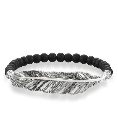 An artfully-finished feather crafted from blackened 925 Sterling silver provides the THOMAS SABO Love Bridge bracelet with its particular Boho look. In addition to matt-black obsidian beads, the black pavé zirconia provides a truly enigmatic sparkle.