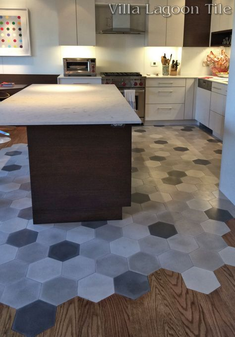 This beautiful New York City installation flows hardwood floors into our mixed gray hex cement tile.