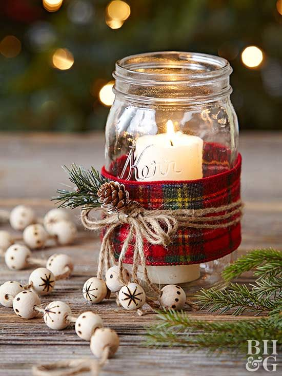 For a Mason jar gift you can make in bulk, try these easy candles. Wrap the jar with wide plaid ribbon. Secure with three jute strings tied in a bow. Hot-glue a pinecone and artificial greenery to the bow. For a final touch, wood-burn a snowflake or polka-dots onto four wooden beads and thread onto four of the string ends. Place a tall, slender pillar candle in the jar.