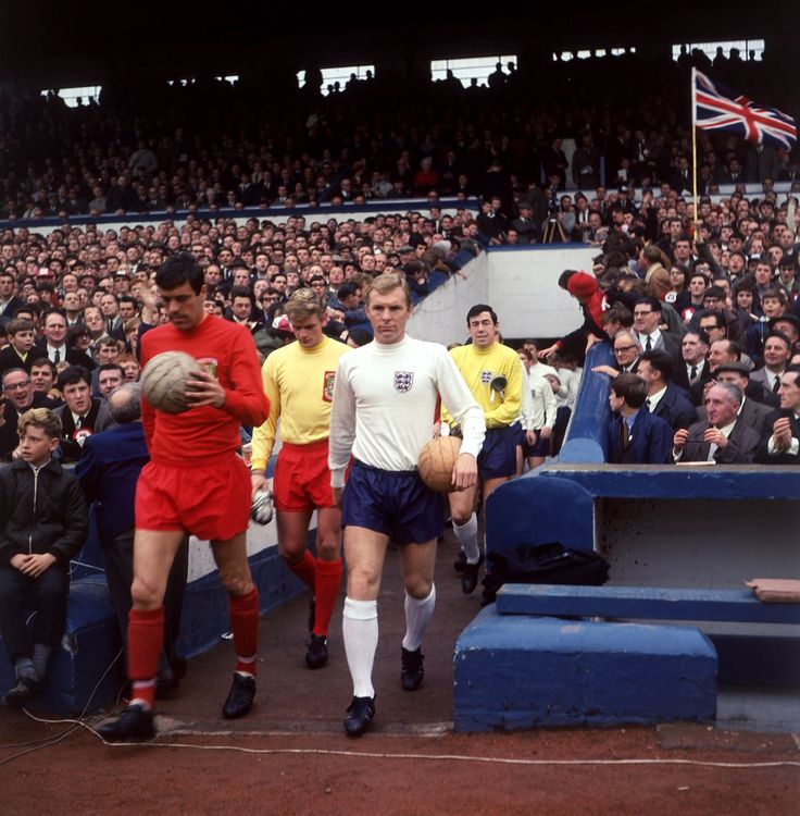 21st October 1967. Wales and England Captain's Mike England and Bobby Moore lead out their sides.