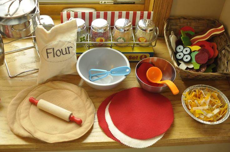 Some ideas. DIY felt pizza dough, etc. Flour sack (canvas). Cheese is cut felt strips & yarn pieces. Lots of help from Melissa & Doug!