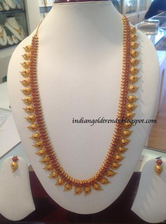 Latest Indian Gold and Diamond Jewellery Designs: 22k gold long ruby mango haram or ruby mango mala