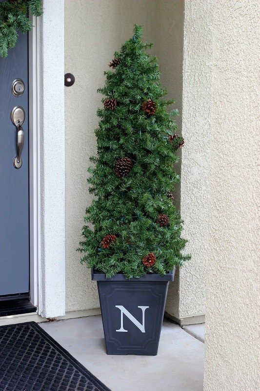 Quick and Easy Evergreen Topiaries - made using a tomato cage and garland