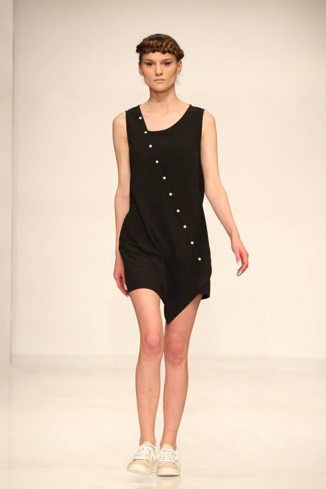 Asymmetric black dress with white buttons.  Order via facebook, pm or e-mail.