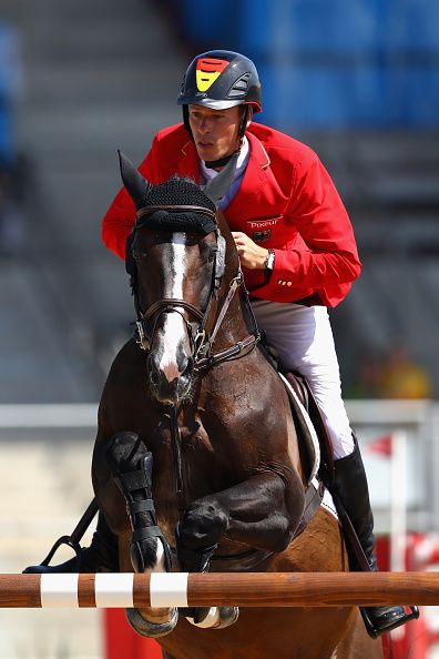 Christian Ahlmann of Germany rides Taloubet Z during the Team Jumping on Day 11…