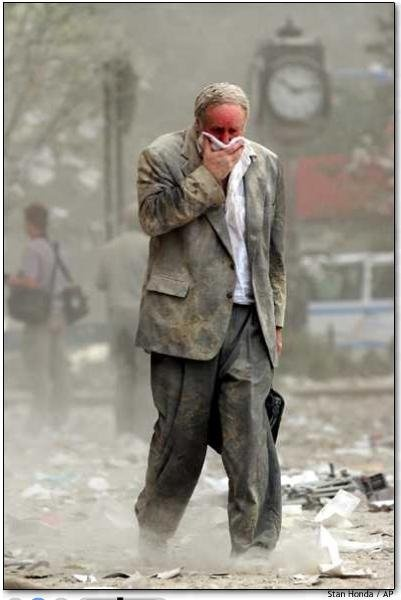"""There is a photograph of a lone office worker by Stan Honda walking home (presumably), holding a piece of cloth in front of his mouth and nose, his clothes covered with dust from the towers. It's impossible for me to imagine what must have gone through the man's mind. #let'snotforget911"