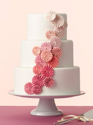 An Ombre Pinwheel Wedding Cake  Pretty round pinwheels in a gradation of pink are an unexpected touch. Cake by Erica O'Brien