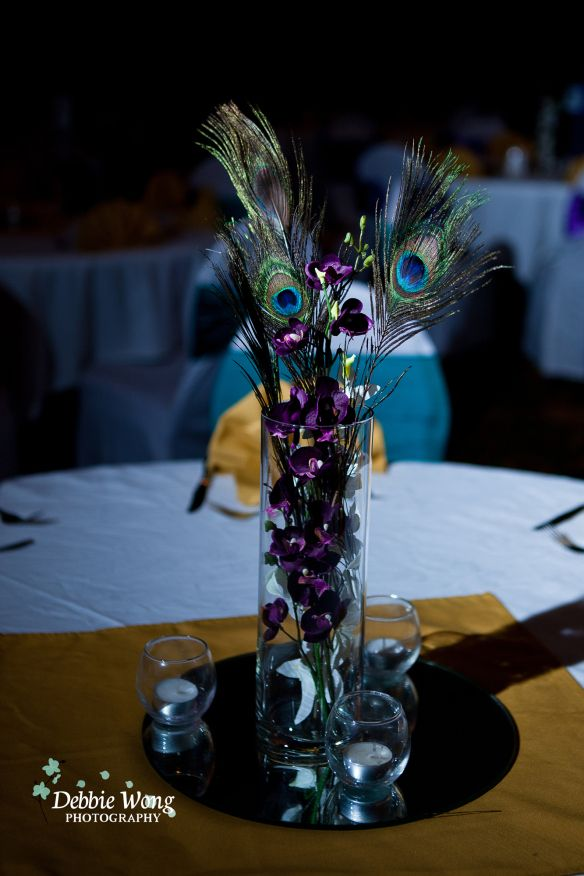 Turquoise and purple colors with peacock feather for table pieces at Coast Plaza hotel.  Debbie Wong Photography, Calgary wedding photography, www.debbiewongphotography.com