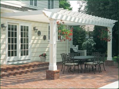 Pergola with Paneled Posts - Attach an imaginative pergola with handcrafted paneled posts that cleverly match the house trim and instantly you have extended your dining room outdoors.