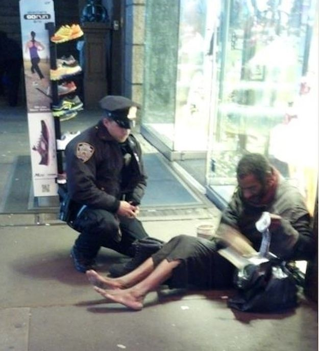 "Jennifer Foster was visiting Times Square on Nov. 14 when she snapped the heartwarming moment. ""Right when I was about to approach, one of your officers came up behind him. The officer said, 'I have these size 12 boots for you, they are all-weather. Let's put them on and take care of you.' The officer squatted down on the ground and proceeded to put socks and the new boots on this man. The officer expected NOTHING in return and did not know I was watching"""