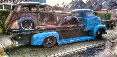 Ford COE with an in progress build in the car hauler flatbed.