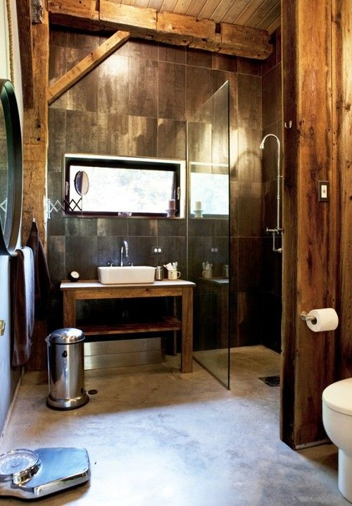 Love the shower with no step up and just a glass wall! And I LOVE the metallic tiles against the warm wood!
