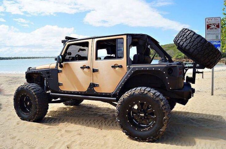 Custom lifted Jeep Wrangler with fender flares. Love the sand color.