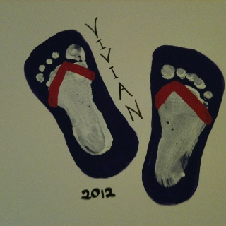 Foot print art  - Best idea I've seen for the barrage (sp?) of hand and footprint pictures!