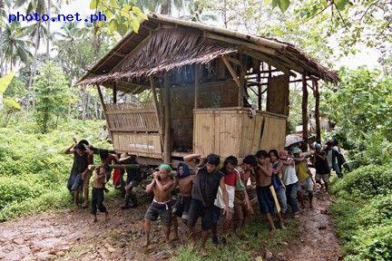 Philippines: locals transporting a nipa hut