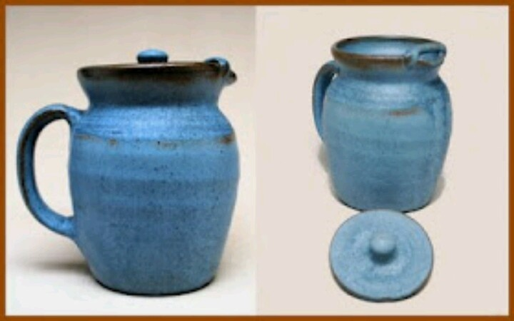 """Ice-water pitcher with lid, Seagrove Pottery """"Crystal Blue"""" glaze, made and glazed by Walter Auman and marked with the date """"1976."""" Walter formulated Crystal Blue in the early 1970s, following the first imposition of Federal restrictions on lead-glazed pottery. The result was a soft, semi-matte finish, lighter in tone than the lead-rutile matte blue previously used by Seagrove Pottery and C. C. Cole Pottery."""