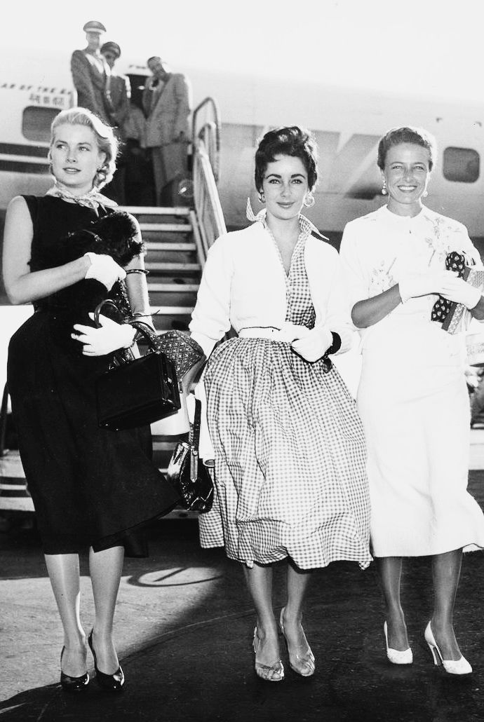 "hollywoodlady: ""  Grace Kelly, Elizabeth Taylor, and Laraine Day arriving at the New York International Airport, 1954 """