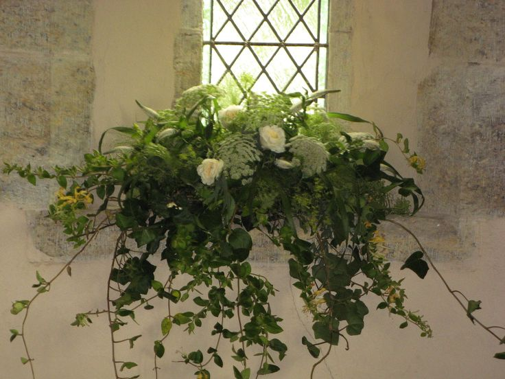 St Mary's Church, Barlavington, windowsills decorated with trailing foliages and scented roses.  Honeysuckle Weeks wedding