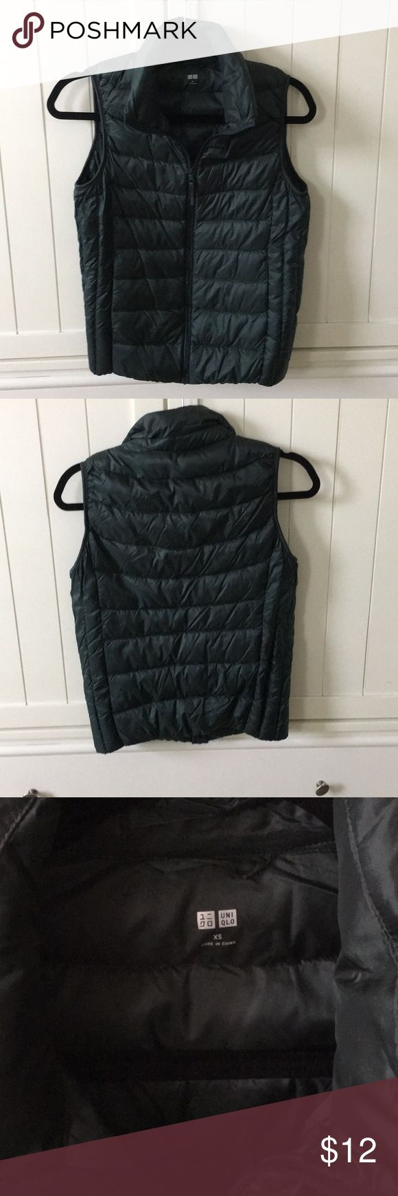 Uniqlo Dark Green Vest Uniqlo Dark Green Vest.  Worn once.  Perfect for this time of year for layering.  90% down filling.  Women's size xs. Uniqlo Jackets & Coats Vests