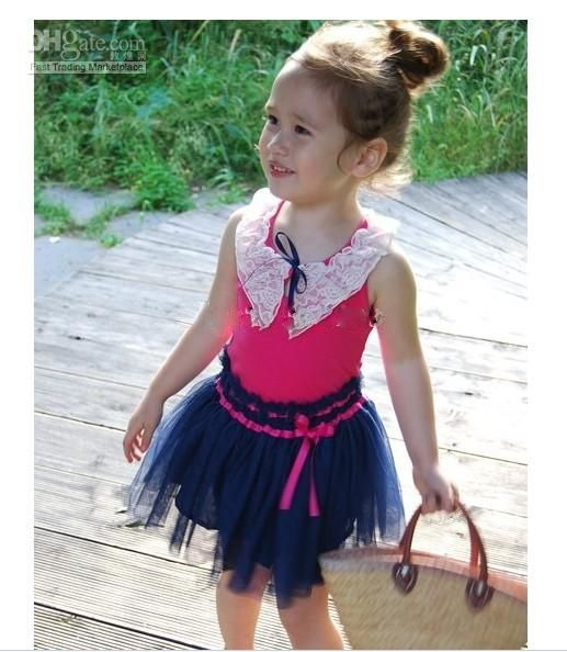 Pink Top Cream Lace Navy Tutu Skirt Accented With A And Belt Sizes Available