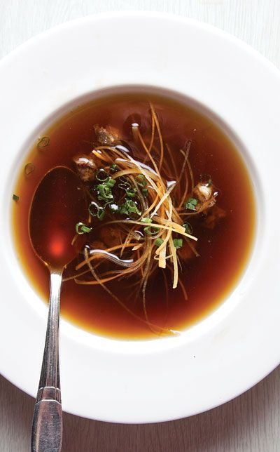 "Ochsenschwanzsuppe (Oxtail Consommé)  To ensure that this consommé is absolutely clear, chef Alexander Kroll of the Widder Hotel in Zurich creates a ""raft"" of ground beef and egg whites to absorb impurities, producing an elegant soup with concentrated flavor. This recipe first appeared in our November 2011 issue along with Beth Kracklauer's story The Art of Soup."
