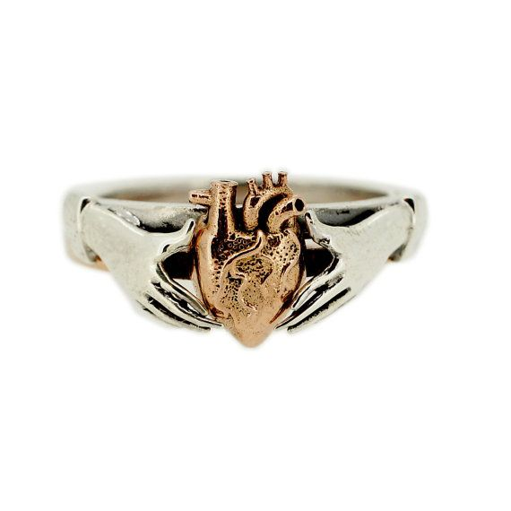 This stacking Claddagh ring set makes a unique wedding and engagement ring set. Fede or claddagh rings feature two hands and have been given