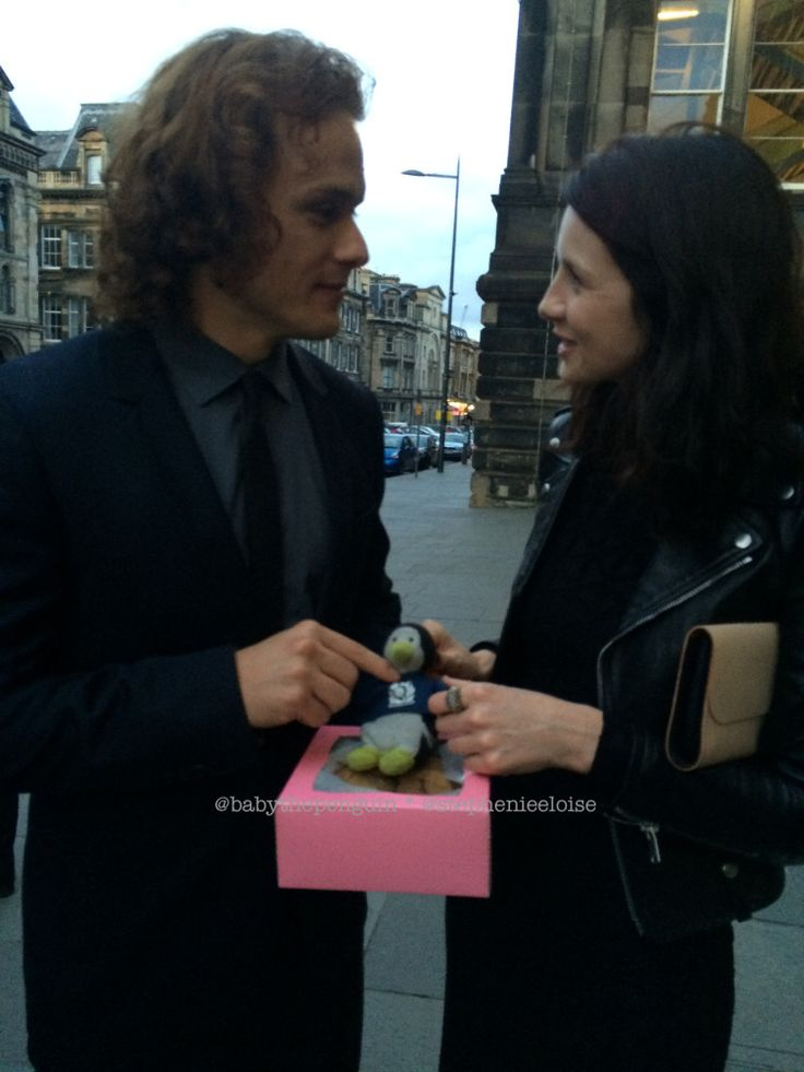 Here's a picture of Sam Heughan and Caitriona Balfe from Edinburgh International Festival, holding Baby the Penguin.